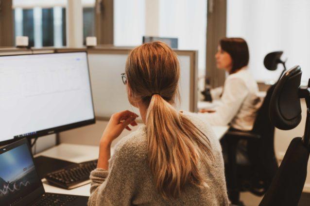 women in front of computers